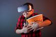 Boy with popcorn in VR glasses