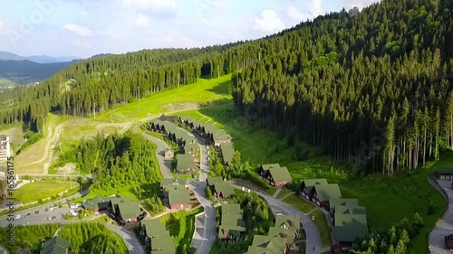 Shooting from above a beautiful resort, houses in the mountains, shooting from a drone