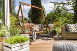House patio with the garden swing - 165566147
