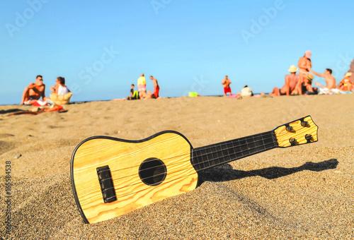 Guitar on the Sand Beach - 165584538