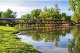 Wooden pedestrian bridge over river in Kolarovo, Slovakia