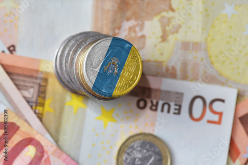 Poster Canarische Eilanden euro coin with national flag of canary islands on the euro money banknotes background