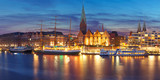 Embankment of the Weser River and Protestant Lutheran Saint Martin Church in the old town of Bremen, Germany. Night panoramic view. - 165617922