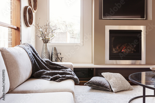 Warm inviting interior with gas log fireplace © Jodie Johnson