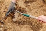Archeological tools, Archeologist working on site, hand and tool. - 165622341
