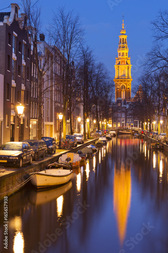 Church and a canal in Amsterdam at night Poster