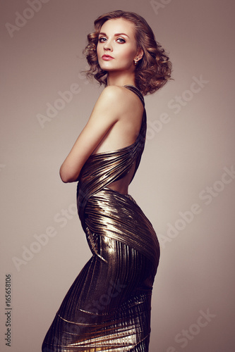 Spoed canvasdoek 2cm dik Kapsalon Fashion portrait of young beautiful woman in gold dress. Brunette glamour lady with perfect make up and hairstyle