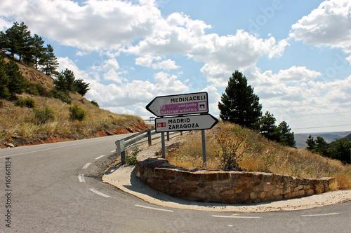 Road signs in a curve leading to Medinaceli, Madrid, or Zaragoza in Spain