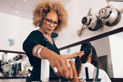 Woman hairdresser at work in salon © Jacob Lund