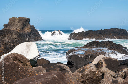 Rocks, waves and breakers at Ballintoy harbor, Northern coast of County Antrim, Northern Ireland, UK Poster