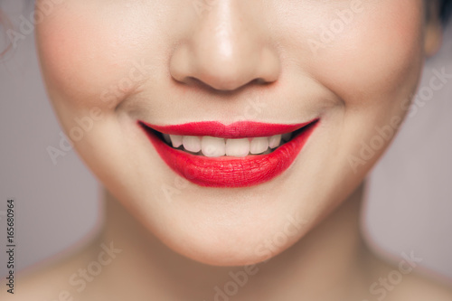 Red Sexy Lips closeup. Make up concept. Beautiful Perfect Lips. Poster
