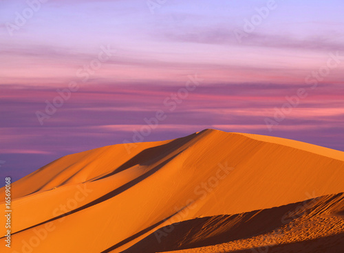 Beautiful sunset over sand dunes abstract background. Sahara desert in Morocco, Africa