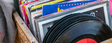 garage sale display of LPs and vinyls for music collectors - 165696508
