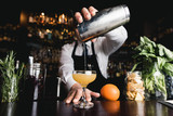 Bartender pouring cocktail - 165729135