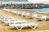 White sunbed on the sand beach at the sea, summer sea rest concept.