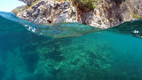 Half underwater close up, background split by waterline, Turkey, Mediterranean Sea,
