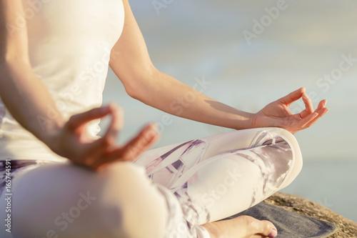 Fototapeta yoga woman meditating outdoors