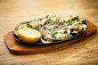Baked mussels with cheese - 165748991