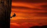 Climber silhouette over beautiful sunset - 165774353