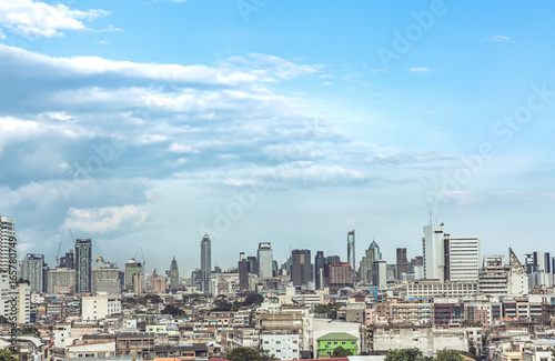 Bangkok, cityscape Many building and construction. The top of view on skyscraper. Urban life background, aerial shot of urban metropolis scenery with blue sky. Business building background.
