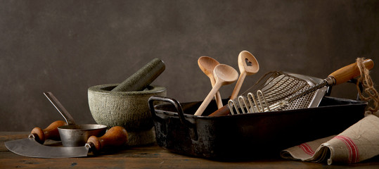 Kitchen utensils on wooden table © exclusive-design
