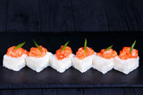 Delicious pressed sushi Oshi zushi with cream cheese and salmon, Japanese food art