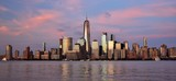 The Financial District and skyline of downtown Manhattan at sunset.