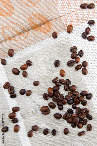 Coffee beans scattered on tablecloths
