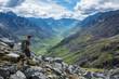 Man hiking down steep trail in the Talkeetna Mountains, Alaska