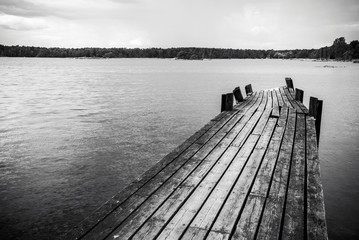Old wooden foot bridge in sea