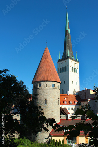 Old town of Tallinn with bell tower of Saint Olaf's church against blue sky Poster