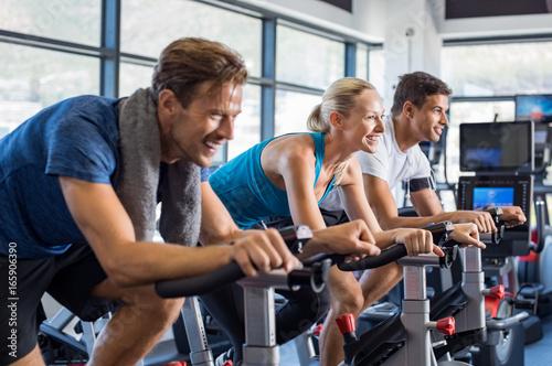 Leinwanddruck Bild People on exercise bike