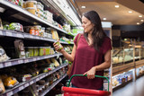 Woman shopping in supermarket - 165906537