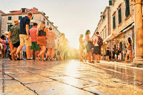 Fototapeta Crowds of tourists at Stradun Street in Dubrovnik at sunset