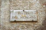 Piazza del Mercato Street sign of wall Siena
