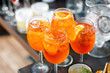Aperol spritz cocktail in misted glass, selective focus