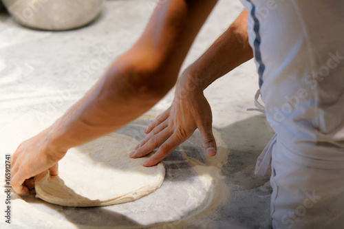 Preparation of homemade pizza dough in pizzeria restaurant Florence
