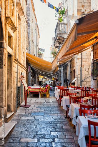 Fototapeta Street terraced cafe of Dubrovnik