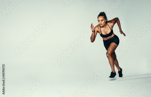 Hispanic female runner working out in studio - 165916751