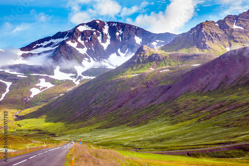 Tuinposter Aubergine Road among snowy mountains rhyolite