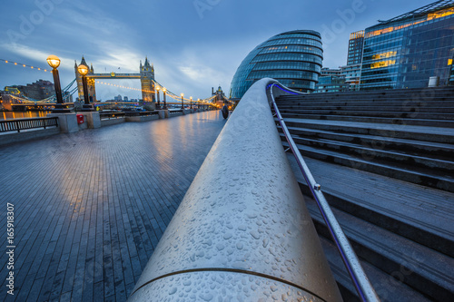 Fotobehang London London, England - Tower Bridge and office buildings on a rainy day at blue hour