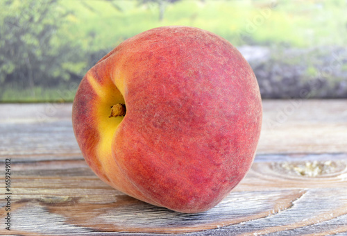 The peach is on a table. Fruit is fresh, juicy, mature, tropical. - 165924982