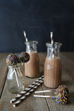 Chocolate milk with cake pops and straws
