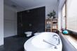 Quadro Modern bathroom with black tiles