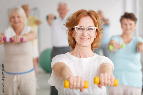 Lady exercising with dumbbells
