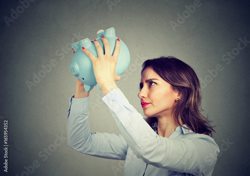 Worried woman with empty piggy bank Poster