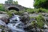 Water under the bridge gentle stream stone old