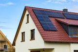 roof with solar panel on a new house - 165963503