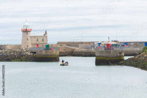 Howth harbor in Ireland, lighthouse and boat Poster