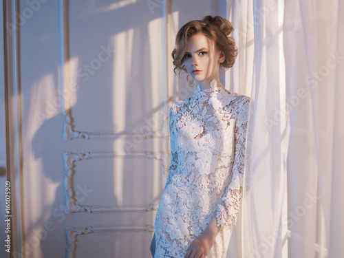Foto op Aluminium womenART Woman in lace dress at the window